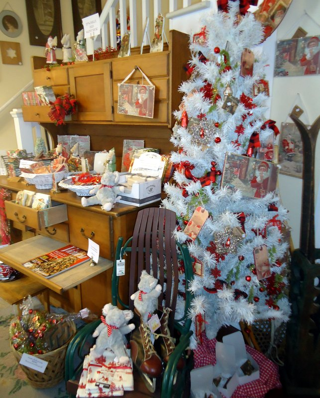 It's Jolly Old St. Nick!  Ornaments, shelf & mantle standups, gift tags, even room fresheners with cranberry scent.  By Bethany Lowe, Primitives by Kathy and Punch Studio.