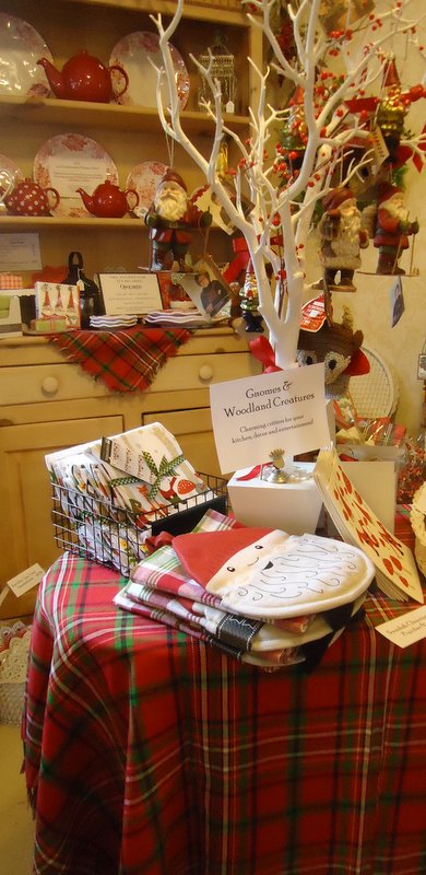 There's nothing like holiday red and green to stir the senses!  April Cornell plaid linens, cute kitchen pieces by NOW Designs and fun Gnorman the Gnome!